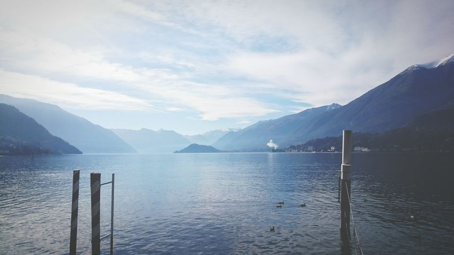 Light Blue Blue Blue Sky Shades Of Blue Mirage Appearance Fading Taking Photos Lakeshore Water Pastel Power Here Belongs To Me Landscapes With WhiteWall Lake Faded Sea Light Landscape Como Lake Como Mountains Reflection Mood Disappearing Into Nothing Learn & Shoot: Balancing Elements Summer Exploratorium