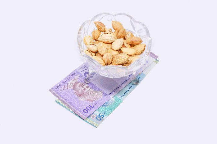 The Almond ( Prunus Dulcis ) With money Money Almondchocolate Almondshell Almondjoy Almondcroissant AlmondOil Almond Cookie Almond Tree Almondtree Almond Tree Granola Wealth White Background Studio Shot Paper Currency No People Healthy Eating Close-up Day