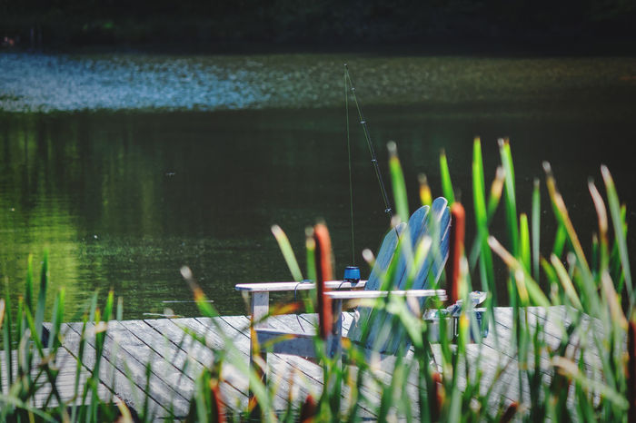 To see more of my work head to http://www.timothybarkerjr.com/ Fishing Landscapes And Lakeviews Lake View Lakeshore Fishing Pole Relaxing Tranquility Reeds, Weeds, Marshland, Marsh, Reeds At The Lake Water Decking Dockside Docks Wooden Chair Chair