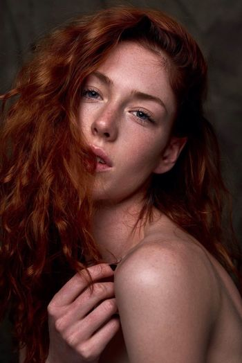 Close-Up Portrait Of Beautiful Young Woman With Redhead