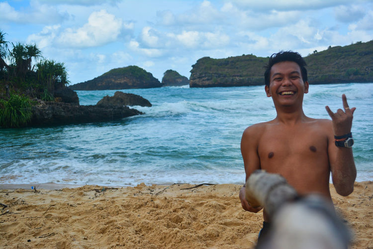 Tour on the Srau Beach. Pacitan, East Java, Indonesia One Person Shirtless Water Beach Real People Sea Leisure Activity Portrait Lifestyles Smiling Front View Beauty In Nature Happiness Nature Young Adult Sky Looking At Camera Land Outdoors EyeEm Best Shots EyeEmNewHere EyeEm Nature Lover EyeEm Selects EyeEm Gallery Nature Autumn Mood