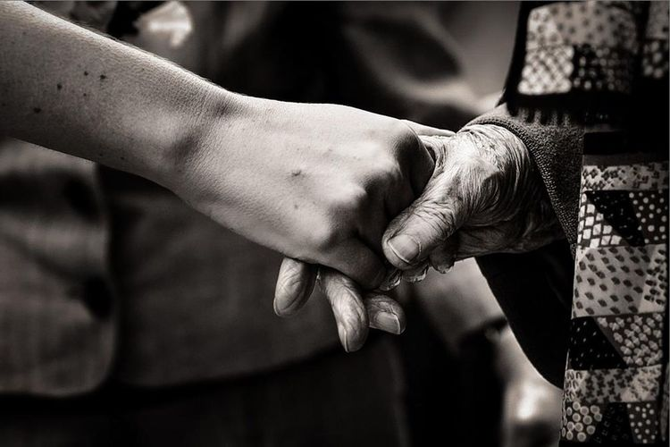 Cropped Image Of Woman Shaking Hand With Friend