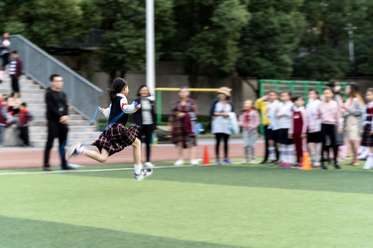 Girl Skipping On Field During Race