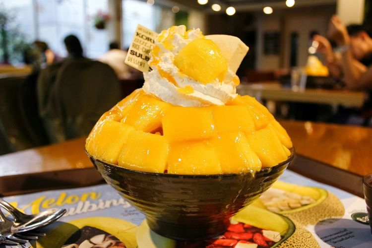 Indoors  Focus On Foreground Food And Drink Table Food Fruit Mango Ice Cream Bingsu Yellow Wipped Cream Bokeh Delicious