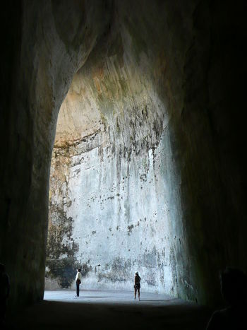 Arch Beauty In Nature Cave Day Dionysus Ear Of Dionysius Indoors  Leisure Activity Lifestyles Men Nature One Person People Physical Geography Prison Real People Rock - Object Rock Formation Silhouette Spy Stalactite  Standing Vacations Water Women
