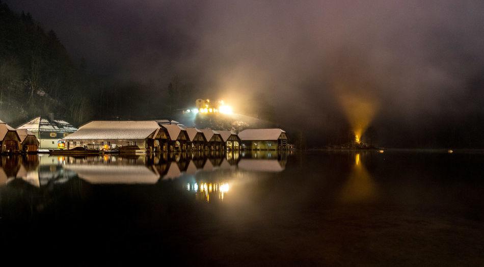 Panoramic view of illuminated lights on lake at night