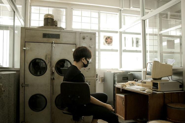 Man sitting in operation lab room
