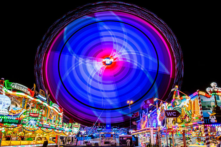 Night Amusement Park Ride Amusement Park Arts Culture And Entertainment Illuminated Multi Colored Ferris Wheel Spinning Motion Blurred Motion Long Exposure Glowing Low Angle View Nightlife Fairground