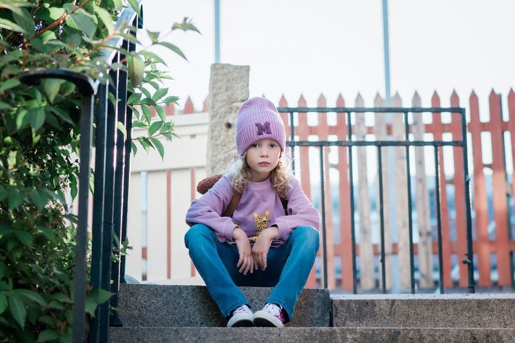 Portrait of girl sitting outdoors