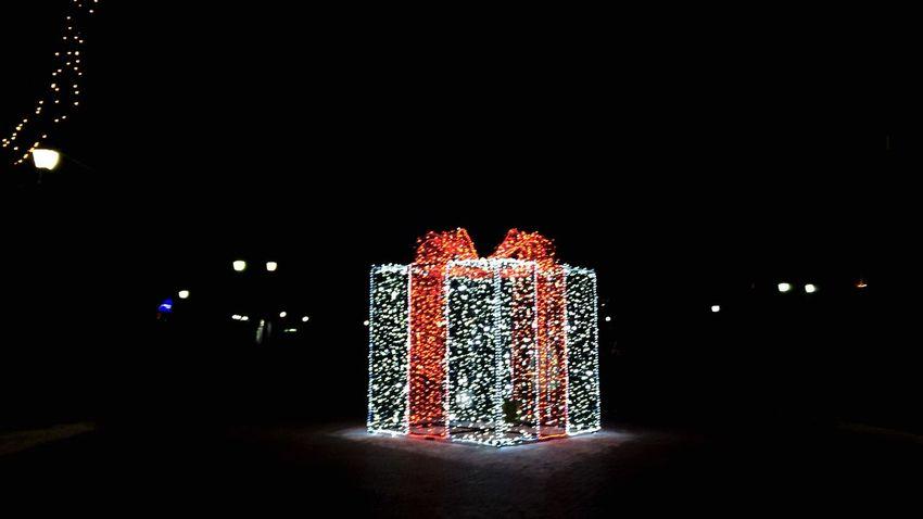 Gift Illuminated Geometric Shape Cube Holiday Weekend Park Decor Sculpture Architecture Gift Pleskavica Pskov Saint Petersburg Russia Christmas christmas tree Christmas Decoration Celebration Illuminated Black Background Christmas Lights Night Christmas Ornament