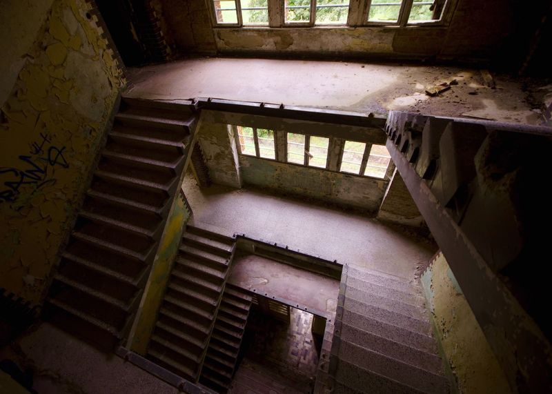 EyeEm_abandonment My Eyes For Architecture Staircase Steps Steps And Staircases Railing High Angle View Architecture Indoors  Built Structure Abandoned No People Day Spiral Staircase