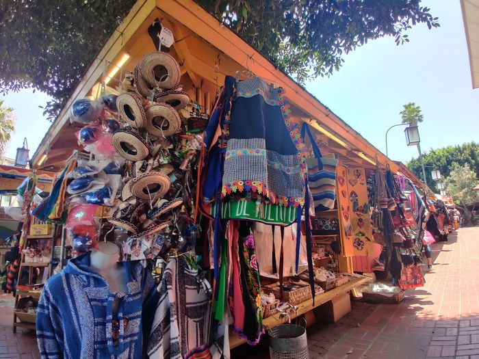 Clothes hanging at market stall