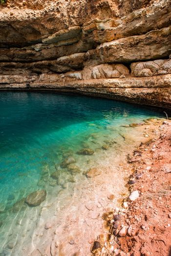 Oman Chapters Water Rock Rock - Object Solid Beauty In Nature Rock Formation Scenics - Nature Sea Tranquility Nature No People Tranquil Scene Day Land Non-urban Scene Idyllic Outdoors Physical Geography Transparent Turquoise Colored Shallow Marine