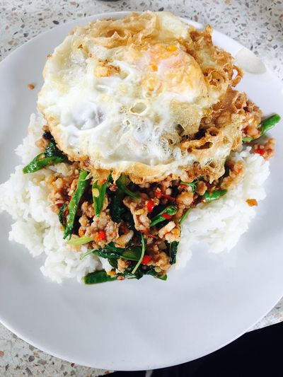 Fried Egg Over Easy / Runny / Dippy Ice Topped With Stir-fried Pork And Basil Food Basil Chilli Long Bean / String Bean Garlic Pig Rice 🍽🍽😊😊😍😍
