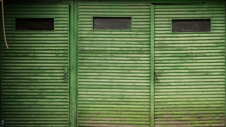 Full frame shot of closed shutter of building