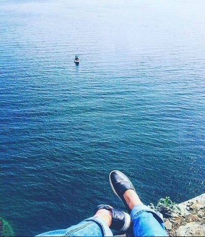 Water Human Leg Personal Perspective Low Section One Person Blue Sea Day High Angle View Nature Human Body Part Real People Leisure Activity Lifestyles Outdoors Men Sitting Beauty In Nature One Man Only