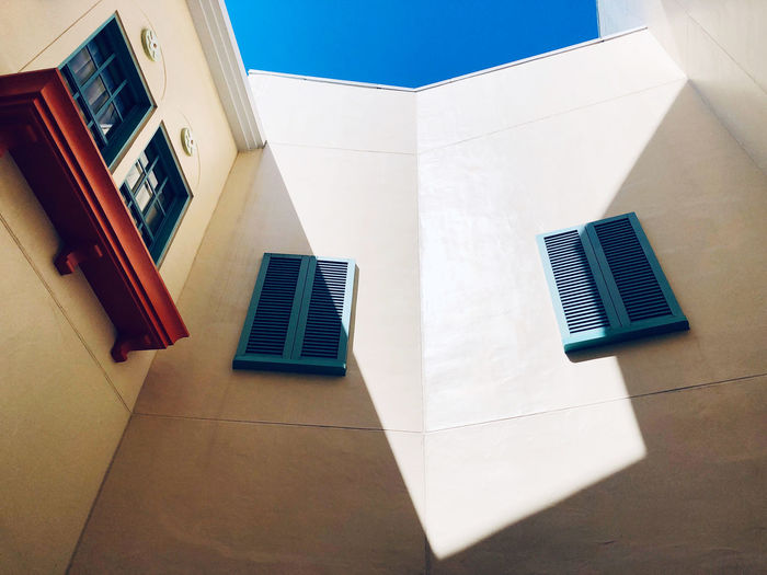 High angle view of white building on table against blue wall