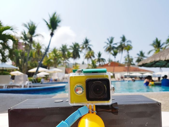 Close-Up Of Camera By Swimming Pool