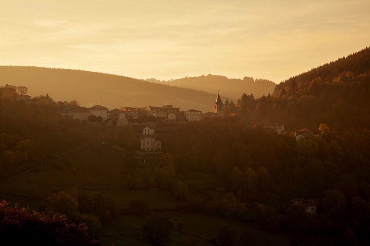 Scenic view of village landscape against sky