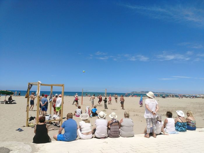 People At Beach Against Blue Sky During Sunny Day