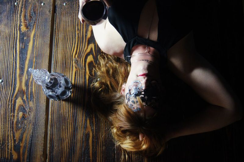 Directly above shot of woman wearing mask lying down on table