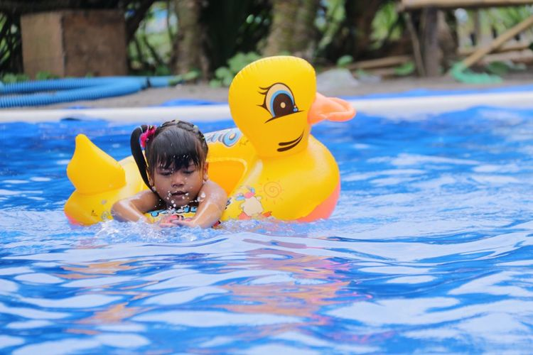 Boy playing in swimming pool