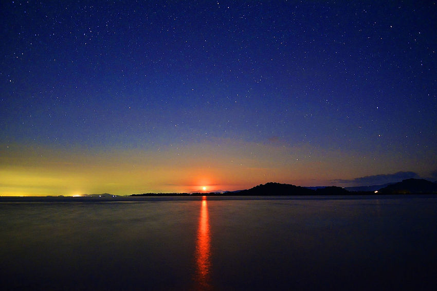 Red Moon Over Gili Layar Island Astronomy Beauty In Nature Blue Calm Dark Dramatic Sky Idyllic Illuminated Landscape Majestic Moon Mountain Nature Night No People Non-urban Scene Orange Color Outdoors Remote Scenics Sky Space Tranquil Scene Tranquility Water