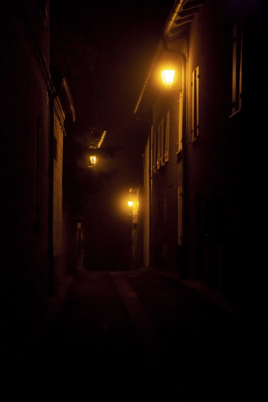 illuminated, night, built structure, architecture, lighting equipment, street, dark, building exterior, street light, no people, the way forward, direction, building, city, empty, residential district, outdoors, absence, light, nature, alley
