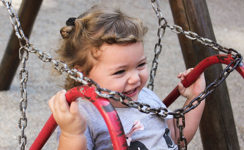 Babygirl Chain Childhood Climbing Close-up Day Girl Girls Gripping Hanging Happiness Holding Leisure Activity One Person Outdoors People Playground Playing Real People Rope Rope Swing Smiling Swing