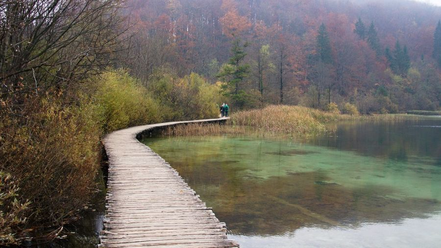People on boardwalk at plitvice lakes national park