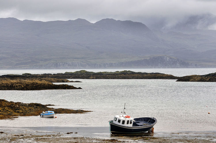 Boats moored at Ardvaser, Isle of Skye Scotland Skye Clouds Coast Highlands Highlands Of Scotland Mist Mountain Nautical Vessel No People Non-urban Scene Outdoors Rock Sea Tranquility Water