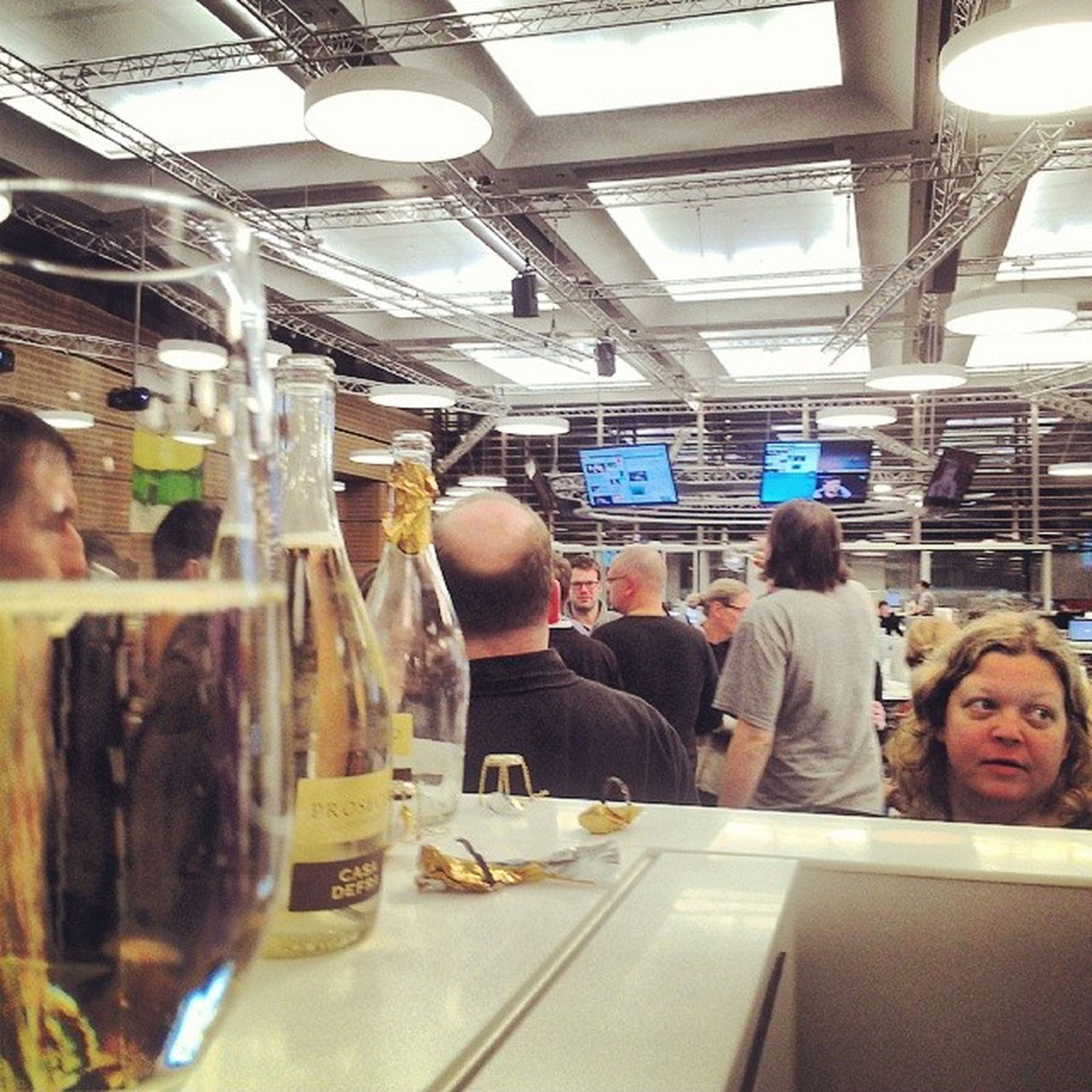 indoors, food and drink, glass - material, lifestyles, transparent, men, window, leisure activity, food, restaurant, sitting, person, table, drink, incidental people, glass, casual clothing