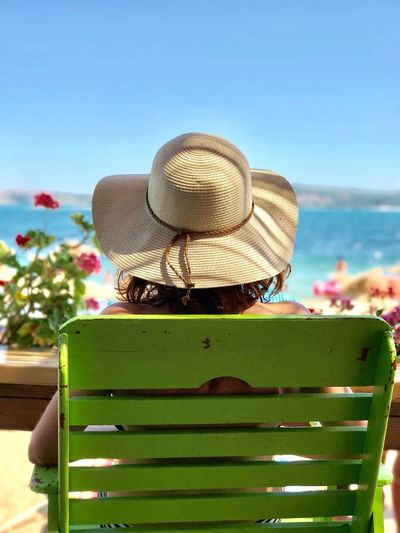 Hat Sun Hat Nature Beauty In Nature Day Rear View Leisure Activity One Person Outdoors Clear Sky Women Sea Real People Water Lifestyles Sky Flower Close-up People Beach Vacations Relaxing One Woman Only Summer Hat