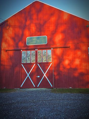 """EyeEm Selects Red Barn Red Barn Structure Farm Built Structure Building Exterior Blue Sky Doors Light And Shadow Shadows Sunlight Sunlight And Shadow Reflection Windows Red Color Painted Red Paint Wood Bokeh White Paint X Marks The Spot Rural Scene Rural America """"Willow Tree Farm"""" Massachusetts"""