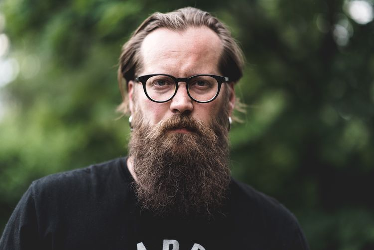 Eyeglasses  Glasses Portrait Headshot Real People One Person Looking At Camera Front View Lifestyles Males  Beard Adult Facial Hair Focus On Foreground Men Mature Adult Mid Adult Leisure Activity Mature Men Human Face The Portraitist - 2018 EyeEm Awards