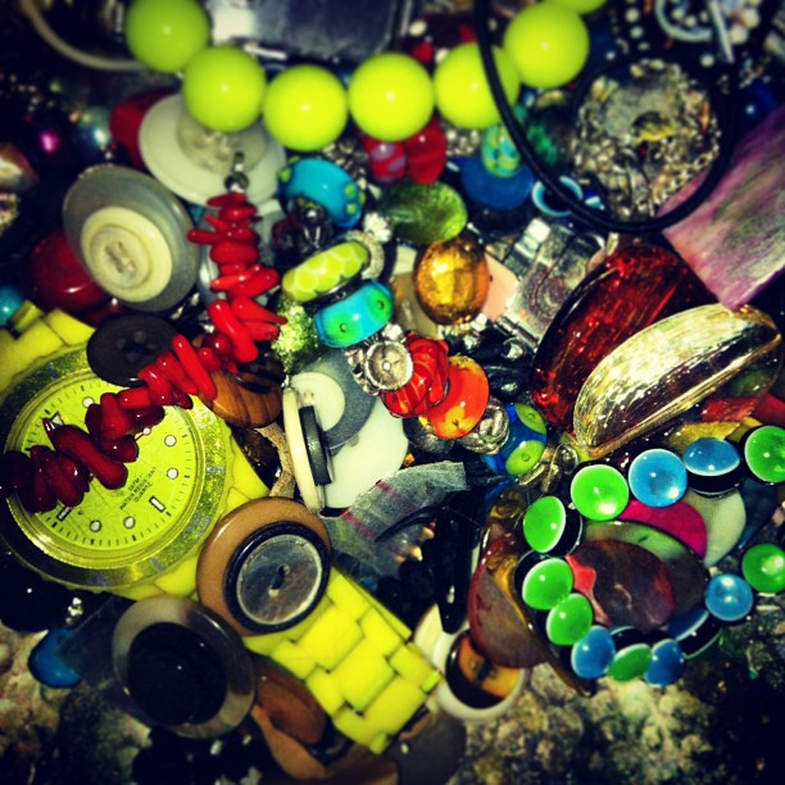 multi colored, variation, large group of objects, abundance, high angle view, colorful, indoors, choice, still life, arrangement, full frame, close-up, no people, collection, backgrounds, toy, circle, plastic, day, group of objects