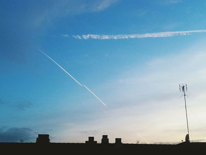 hey Chemtrails Vapor Trail Long Low Angle View Scenics Contrail Airshow Fumes Outdoors No People Business Finance And Industry Air Pollution Nature Sky Day Illuminated