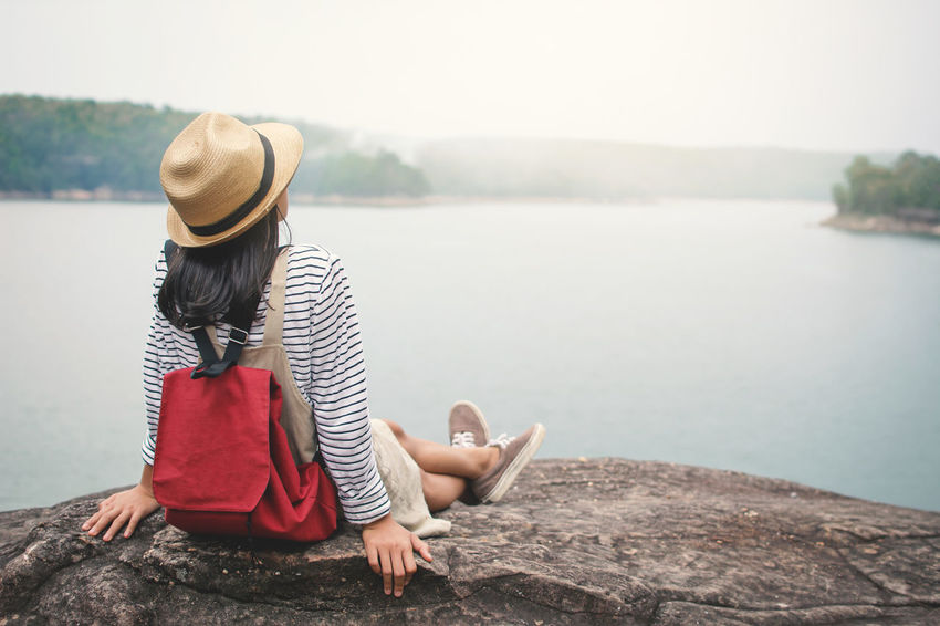 Happiness Relaxing Travel Beauty In Nature Day Girl Hat Holiday Leisure Activity Lifestyles Looking At View Nature Outdoors Real People Sitting Vocation Water Adventures In The City