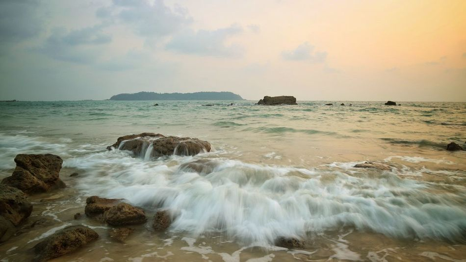 Ngapali beach Beach Sunset Cloud - Sky Water Sea Wave Beauty In Nature Outdoors Landscape Sand Horizon Over Water Rock - Object Long Exposure Sky Tranquility Scenics Nature Day Travel Destinations No People