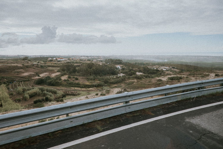 Asphalt Beauty In Nature Day Fence Horizon Over Water Landscape Lane Mountain Nature No People Out Of Window Outdoors Road Scenics Sea Sky Sky And Clouds Street Transportation View Winding Road
