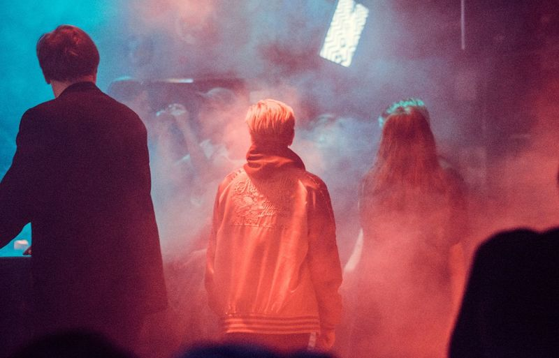Group Of People People Real People Men Rear View Smoke - Physical Structure Night Women Indoors  Illuminated Lifestyles Incidental People Waist Up Clothing Adult Standing Architecture Event Motion Raven - Bird Concert Neon Light Smoke Foggy