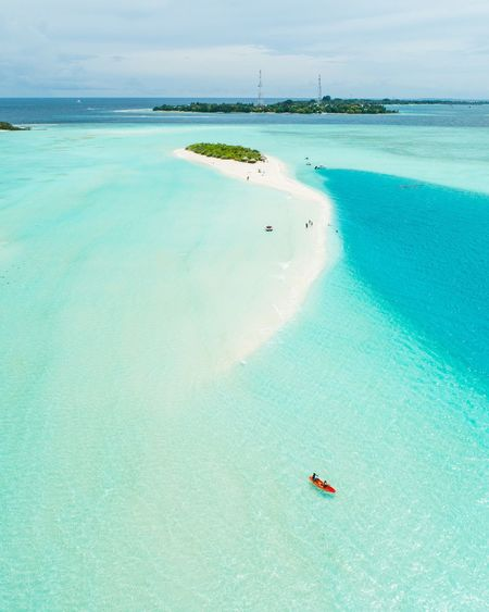 Maldives. A picnic island Water Sea Scenics - Nature Beauty In Nature Land Tranquil Scene Day Tranquility Nature Turquoise Colored Non-urban Scene High Angle View Nautical Vessel Idyllic Beach Blue Outdoors Transportation Sky Horizon Over Water