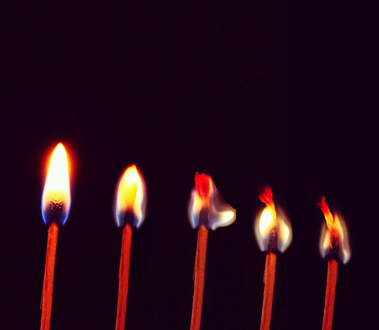 flame, fire, burning, heat - temperature, fire - natural phenomenon, indoors, close-up, candle, side by side, copy space, no people, studio shot, glowing, black background, matchstick, red, nature, in a row, food and drink, sweet food, order, temptation, birthday candles
