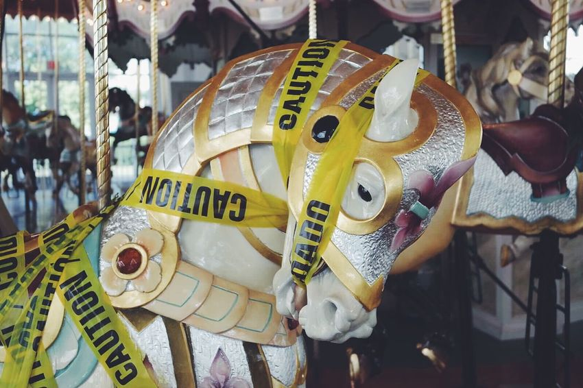 Carousel Carousel Horse Beautiful Carousel Horse Caution Cuidado Caution Tape Broken Out Of Service Paint The Town Yellow