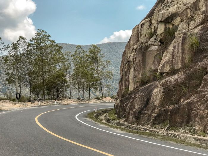Vietnamese Nature Travel Destinations Travel Photography Travel Road Rocky Mountains Rock Formation Mountain Road Mountain Sky Road Transportation Cloud - Sky Day Symbol Nature Road Marking No People Marking Sign Sunlight Direction Tree Street The Way Forward Empty Road Outdoors Curve Plant