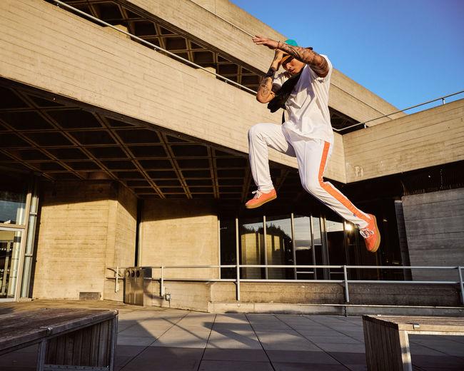 Model: Lance O'Doherty (Insta: @lance_ldn) Free Running  Leaping For Joy Architecture Building Building Exterior Built Structure Clothing Day Full Length Jumping Jumping For Joy Leisure Activity Lifestyles Low Angle View Mid-air Motion Nature One Person Outdoors Railing Real People Success Sunlight A New Beginning Redefining Menswear The Architect - 2019 EyeEm Awards
