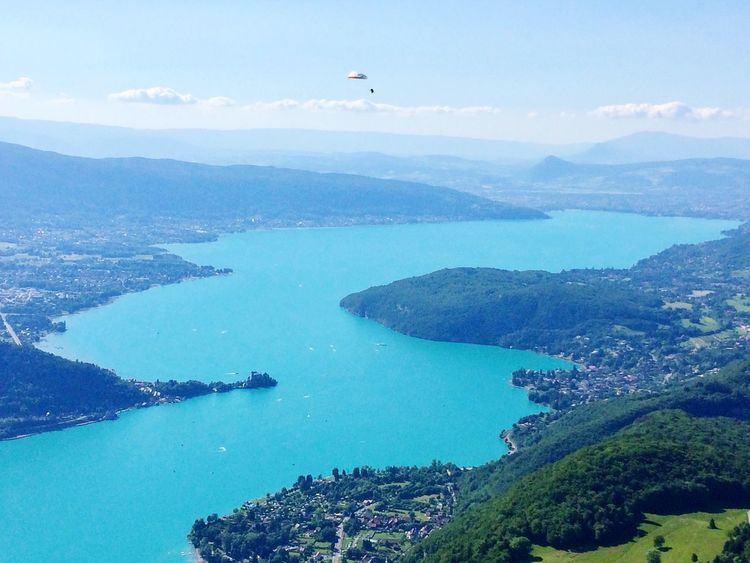 Water Mountain Sea Nature Scenics Day Outdoors Mid-air Beauty In Nature Sky Paragliding Leisure Activity Blue Parachute Flying Adventure Real People Extreme Sports One Person Nautical Vessel France Annecy Lake Lake Mountain Range Landscape