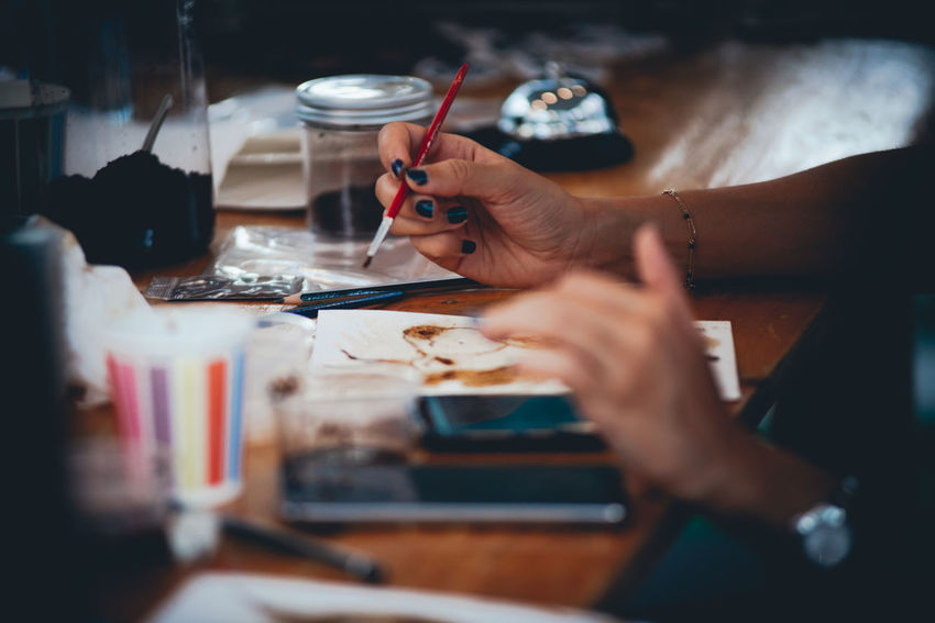 Human Hand Hand Human Body Part Indoors  Real People Selective Focus Occupation Table Working Creativity Artist Holding Art And Craft Technology Adult Women Professional Occupation Design Professional