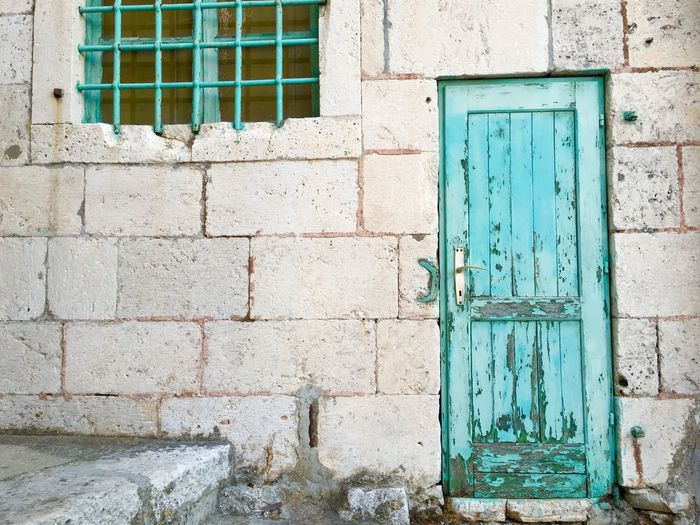 Turquoise door and window Building Exterior Built Structure Architecture Wall - Building Feature Window Brick Wall Outdoors Day No People Close-up Neighborhood Map The Architect - 2017 EyeEm Awards