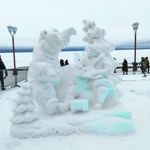 Dog on snowcapped mountain against sky